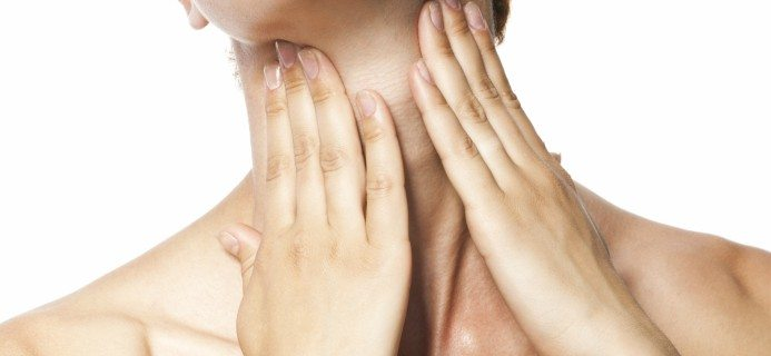 woman-touching-neck-thyroid-by-healthista