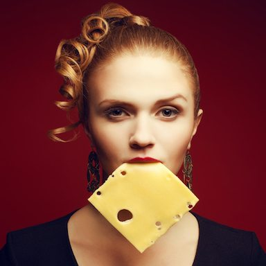 woman-ith-slice-of-cheese-in-mouth-how-you-really-feel-on-diets-by-healthista.com