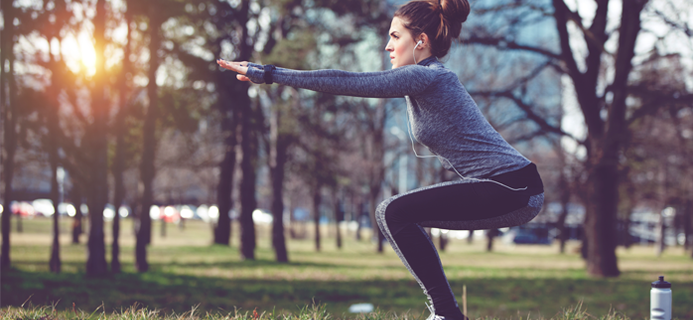 woman-squat-in-park-30-day-hiit-challenge-day-4-by-healthista