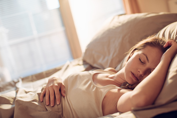 beige woman sleeping, how to keep your new year's resolutions by healthista
