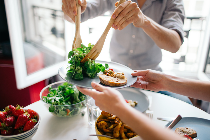 healthy food being dishes out, how to keep your new year's resolutions by healthista