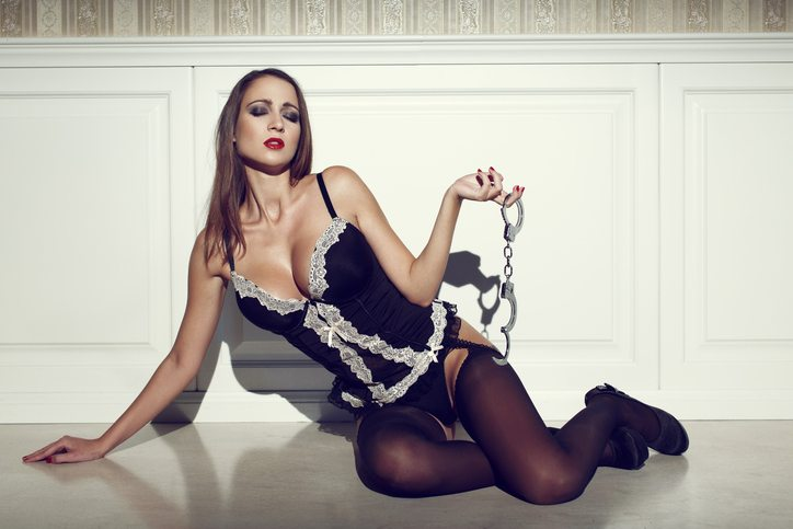 Sensual woman holding handcuffs, Beginners Guide to BDSM, by Healthista.com