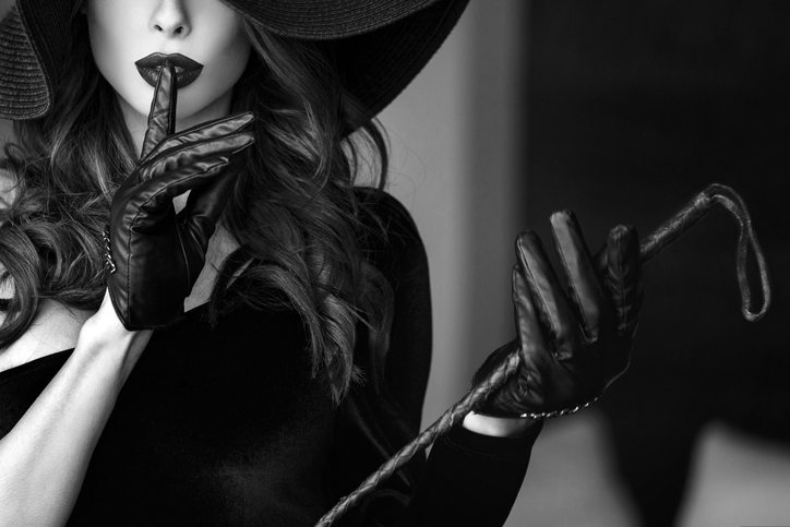 Woman in hat and whip showing no talk,Beginners Guide to BDSM, by Healthista.com