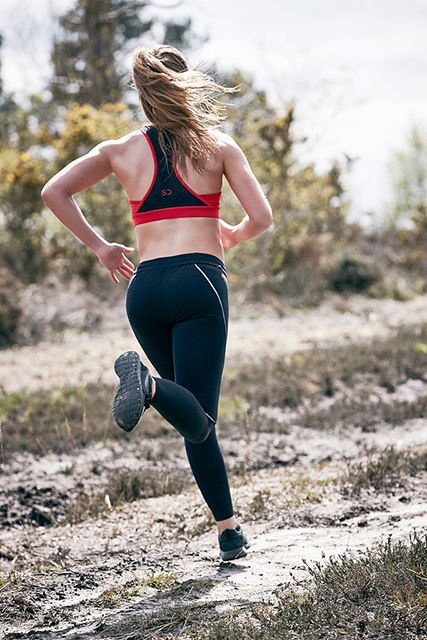woman running in sundried clothes, Best eco fitness brands by healthista