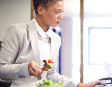 women eating salad at desk, 6 healthy lunch swaps for a nourishing midday meal by healthista