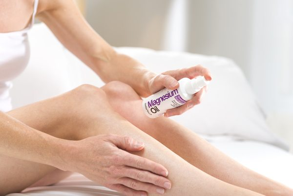 MagnesiumOil_Female-applying-is-magnesium-the-key-to-better-sleep-by-healthista.com