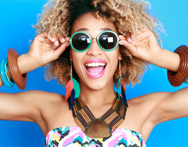happy woman with sunglasses, is happiness overrated by healthista