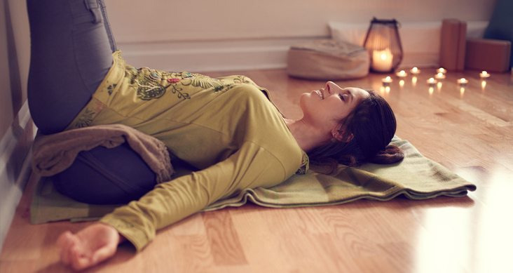 woman-dioing-yoga-at-home-21-days-of-sleep-remedies-by-healthista.com