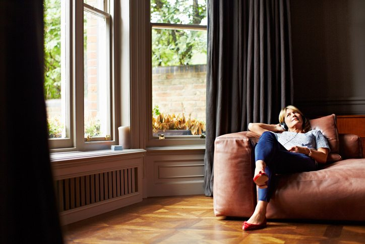 woman relaxing on couch Tired? Bloated? Skin dry and itchy? You might have fatty liver Healthista