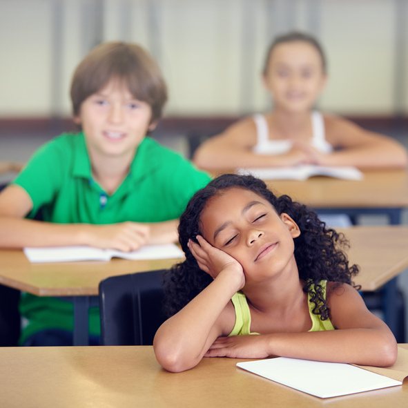 young girl in classroom, women with ADHD by healthista
