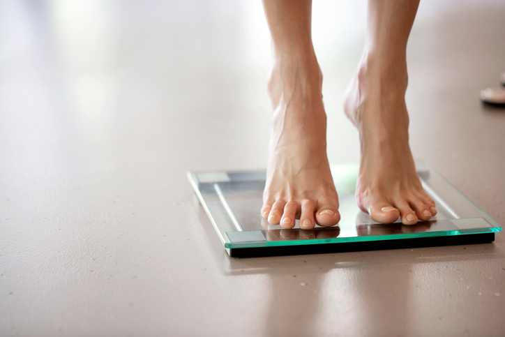 standing on scales, symptoms of coeliac disease to never ignore by healthista