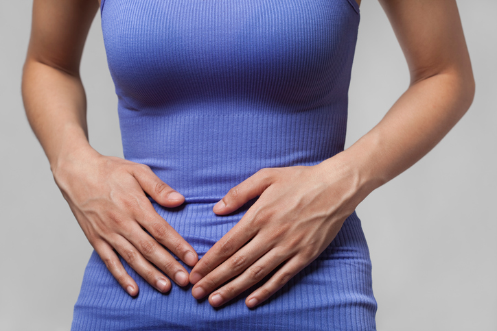 woman with pain in tummy, symptoms of coeliac disease to never ignore by healthista