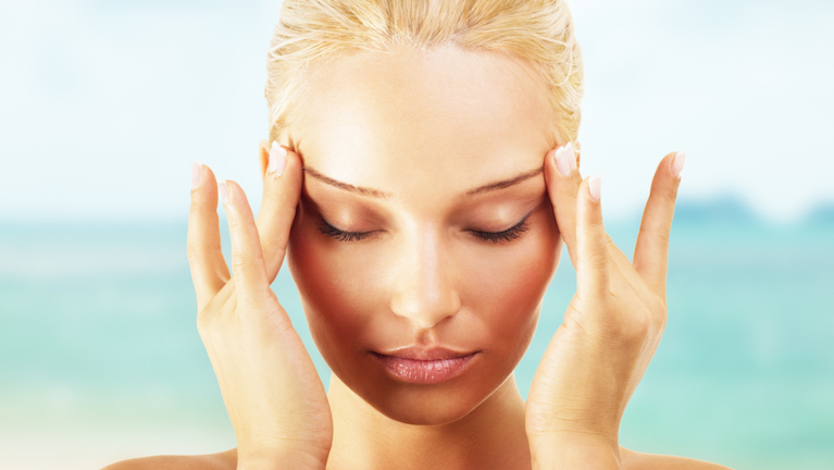 woman-massaging-face-how-to-get-rid-of-puffy-eyes-by-healthista.com-main