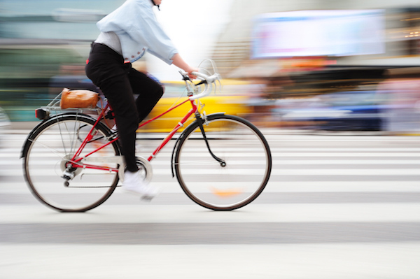 woman-riding-blurred-city-cycle training-plan-made-easy-by-healthista.com-body-image.jpg