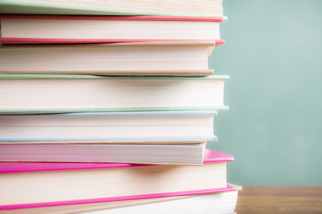 pile-of-books-successful-women-healthista-body.jpg