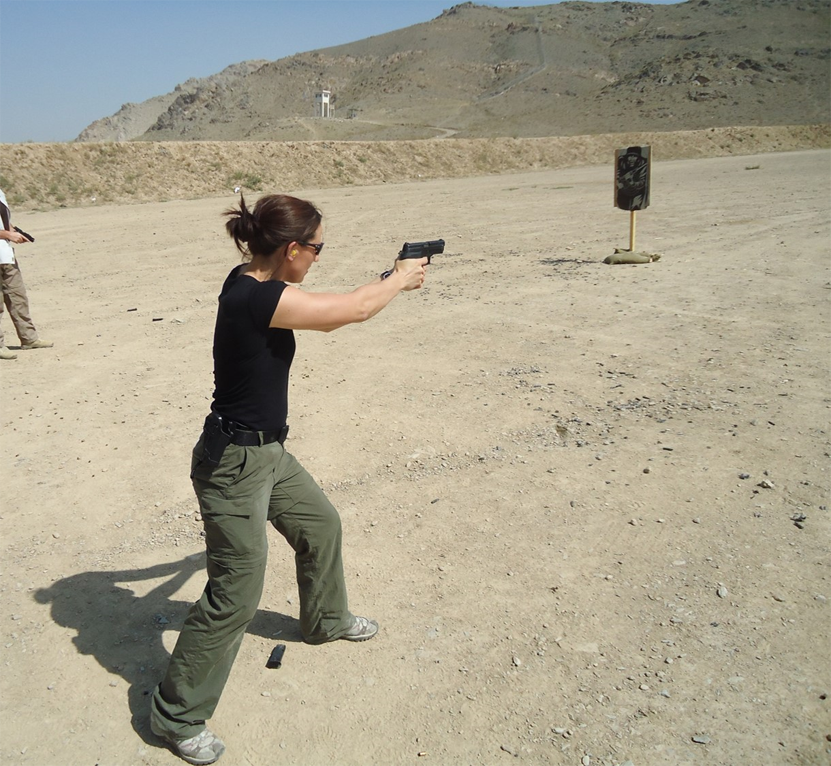 Polly Wilson shooting gun, how does a bodyguard workout by healthista