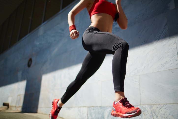 Running outside, Rear view of woman exercising with barbell in gym Is less more when it comes to exercise? 5 signs of overtraining by healthista.com