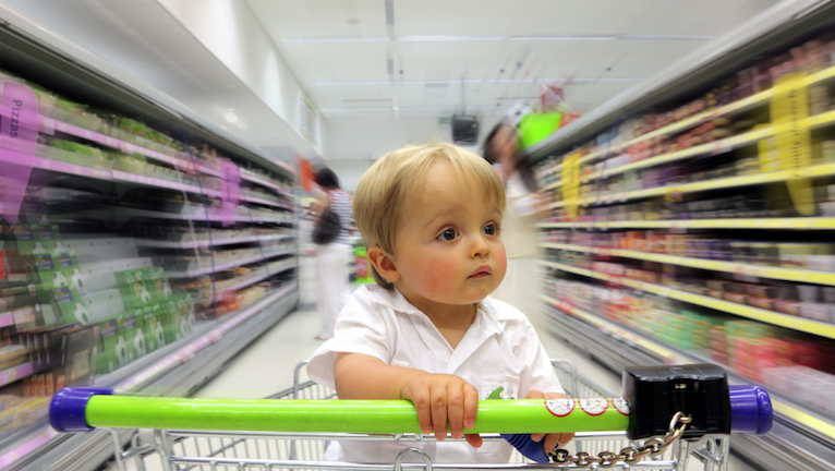 little-boy-in-trolley-how-supermarkets-make-you-spend-money-healthista