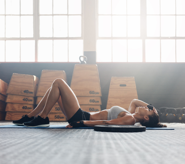 lying on gym matt Is less more when it comes to exercise? 5 signs of overtraining by healthista.com