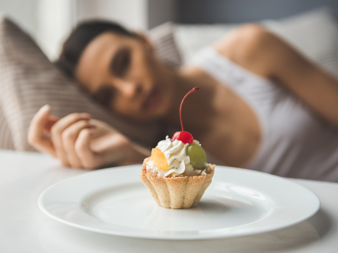 sad woman lying next to cake food shame 7 steps to going dairy-free without missing out on key nutrients plus 3 vegan recipes to help by healthista