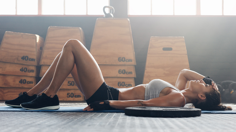 woman resting, best supplements for exercise by healthista.com