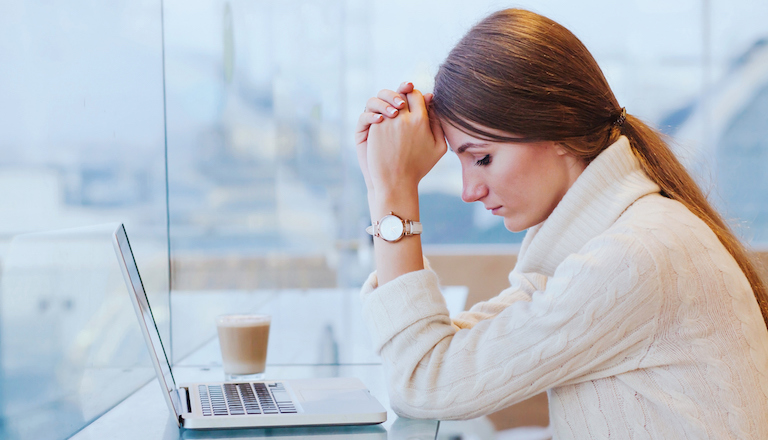 Woman upset Just one in ten people would tell their boss about a mental illness - How to look after your mental health at work Healthista main