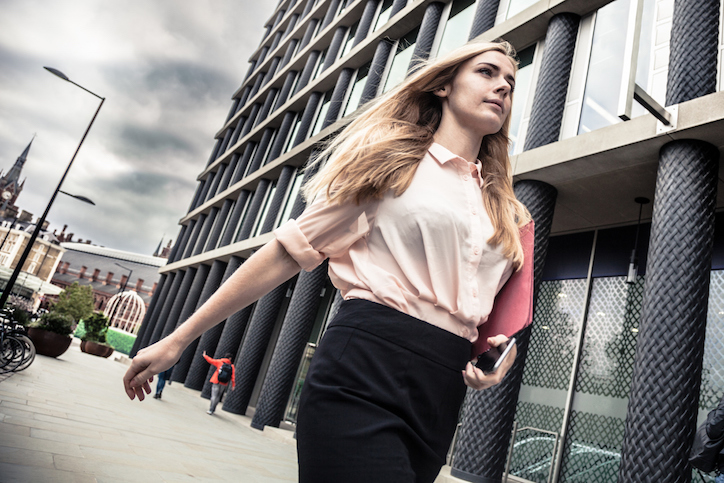 Woman walking Just one in ten people would tell their boss about a mental illness - How to look after your mental health at work Healthista