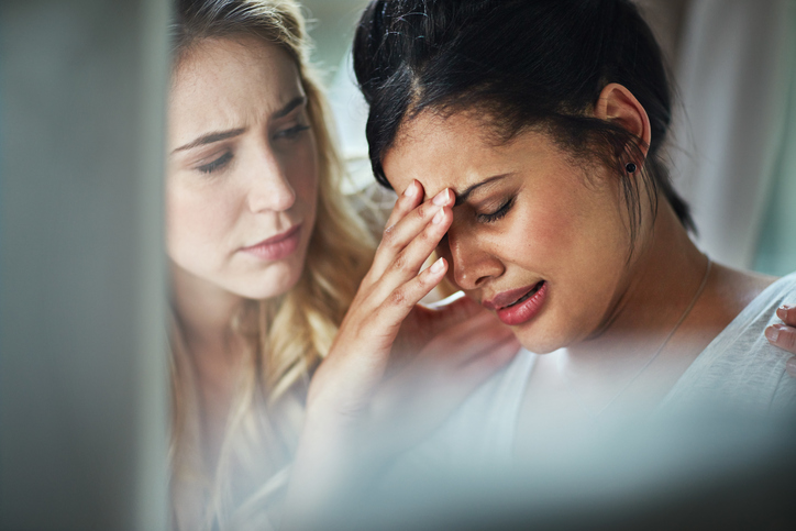 comforting-woman-crying-at-work-yes-or-no-by-healthista.com_