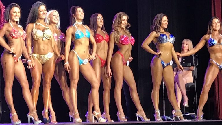 vicky-on-stage-competing-at-Pure-Elite-Bikini-Comp healtista main