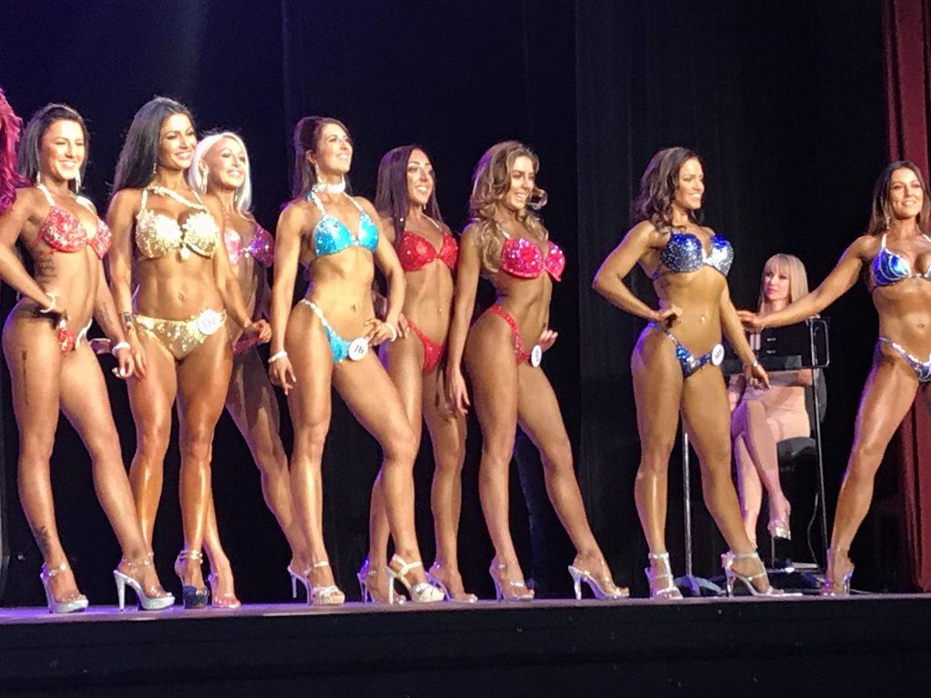 vicky on stage competing at Pure Elite Bikini Comp