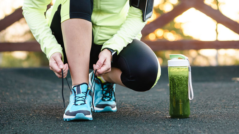 woman-tying-shoe-laces,-Fitness-fads-exposed---#5-skinny-teas-and-juice-cleanses-by-healthista.com