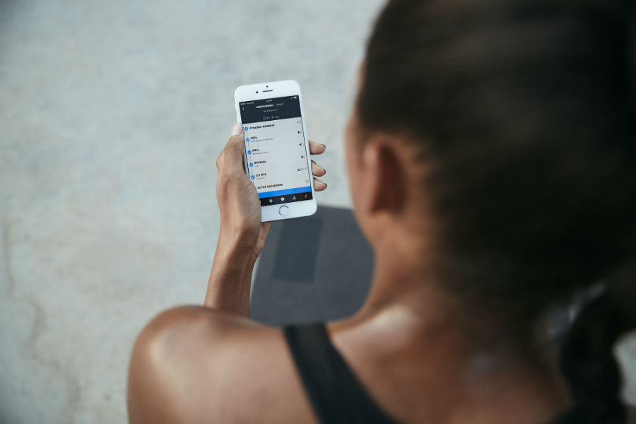 woman using app freeletics, the fitness app powered by AI that can give you your own tailored workout programme by healthista