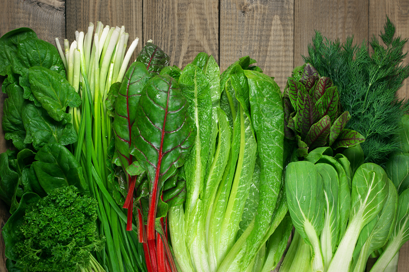 array-of-leafy-greens-on-cutting-board-9-foods-that-could-help-prevent-cancer-if-added-to-diet-healthista