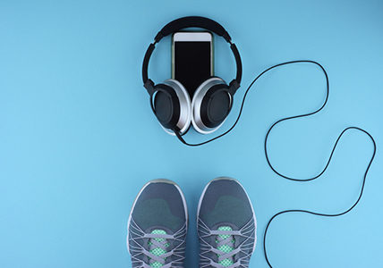 blue-mat-with-workout-shoes-phone-and-headphones-20-rock-songs-thatll-pump-up-your-exercise-routine-healthista
