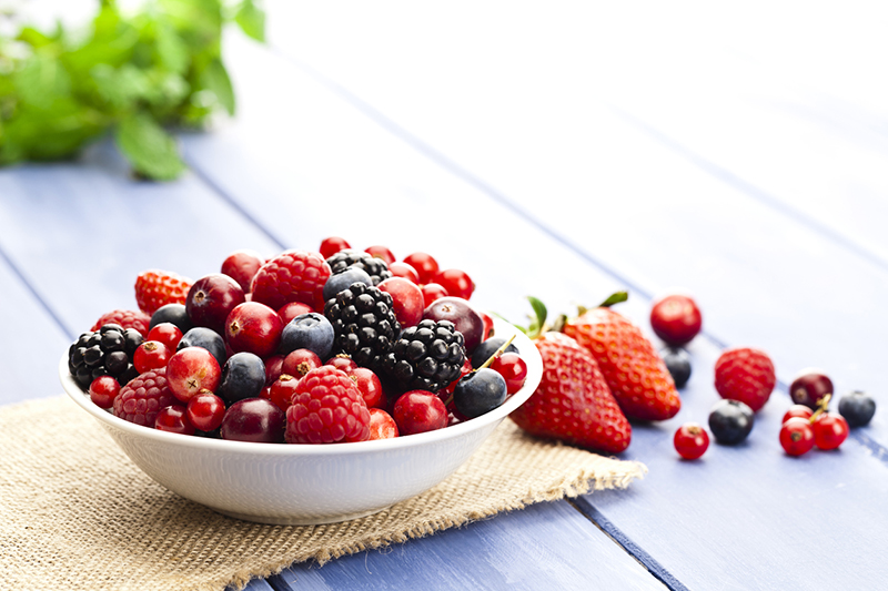 different-kinds-of-berries-in-a-bowl-on-table-9-foods-that-could-help-prevent-cancer-if-added-to-diet-healthista