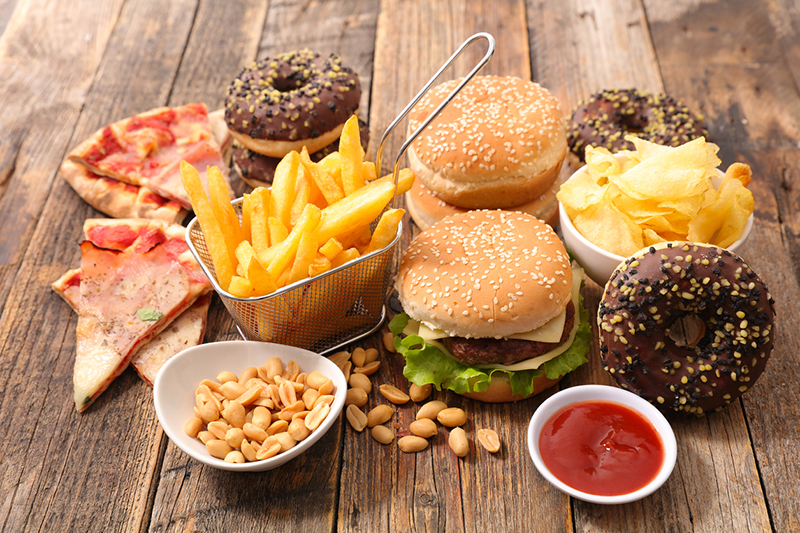 array-of-unhealthy-processed-food-like-burger-fries-and-a-donut-12-ways-to-increase-your-fertility-the-experts-guide-healthista