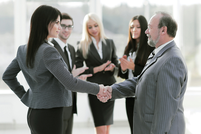 business-woman-shaking-hands-with-buisiness-man-11-life-lessons-from-Shaun-T-healthista