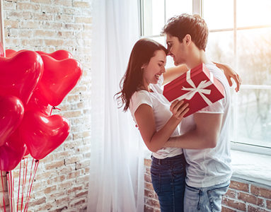 couple-embracing-with-girl-holding-red-gift-8-challenges-long-distance-relationships-face-and-how-to-overcome-them-from-Milena-Nguyen-healthista