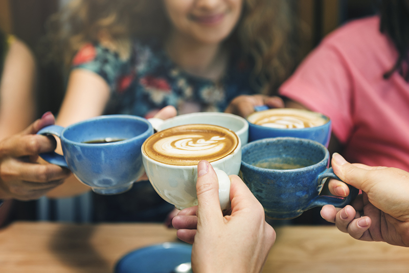 friends-cheering-with-mugs-of-coffee-Easy-self-care-tips-these-wellness-experts-want-everyone-to-do-healthista