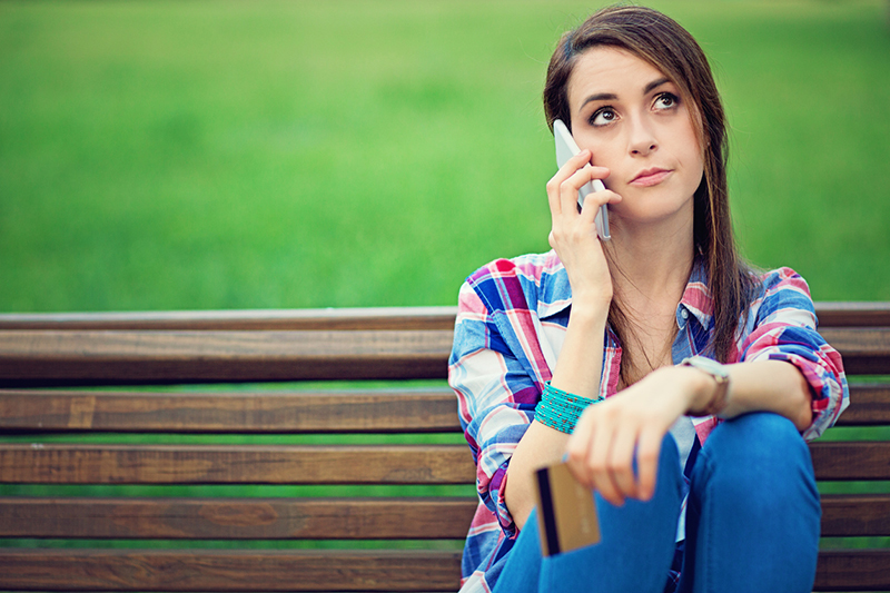 girl-on-park-bench-on-the-phone-8-challenges-long-distance-relationships-face-and-how-to-overcome-them-from-Milena-Nguyen-Healthista