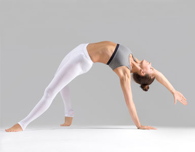 woman-in-yoga-pose,-calming-and-toning-yoga-week-four-by-healthista.com