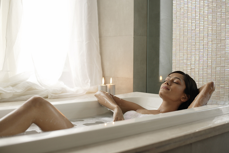 woman-relaxing-in-bath-Easy-self-care-tips-these-wellness-experts-want-everyone-to-do-healthista