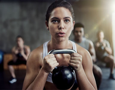 woman-with-Kettlebell,-anti-ageing-workouts-by-healthista.com