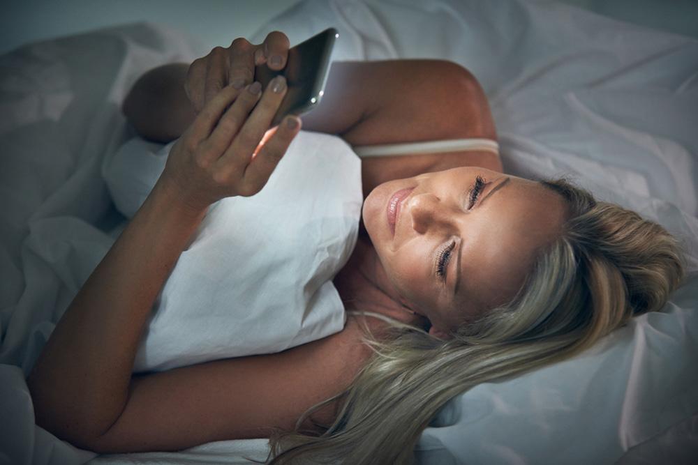 checking phone gut-health-healthista bimuno