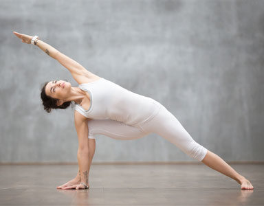 woman-doing-warrior-pose,-Yoga-flow-video-special--Introduction-for-beginners-and-advanced-yoga-by-healthista.com