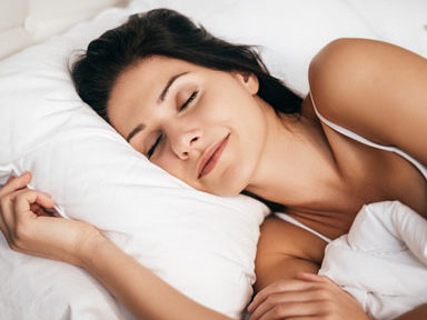woman-sleeping-in-bed,-5-htp-natural-highs-by-heathista