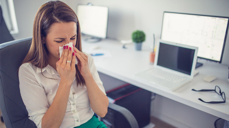 woman sneezing, hay fever, by healthista