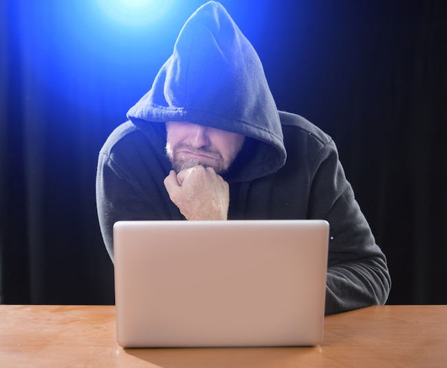 man-in-hood-on-laptop-cyber-stalking-healthista.com_.jpg