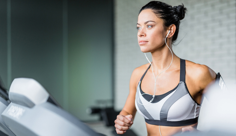 woman on treadmill with earphones in, healthista.com
