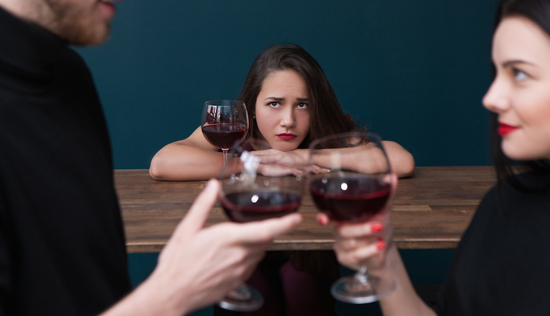 woman-out-looking-sad-out-with-friends-dating-app-healthista.com